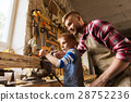 father and son with plane shaving wood at workshop 28752236