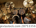 male musician playing drums and cymbals at concert 28753356