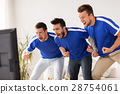 friends or football fans watching soccer at home 28754061