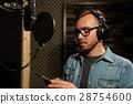 man with headphones at music recording studio 28754600