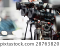 Television cameras at press conference 28763820