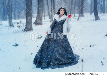 Portrait of young woman dressed in blue coat 28767667