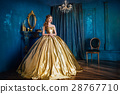 Beautiful woman in a ball gown 28767710