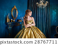 Beautiful woman in a ball gown 28767711