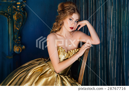 Beautiful woman in a ball gown 28767716