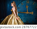 Beautiful woman in a ball gown 28767722