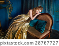 Beautiful woman in a ball gown 28767727