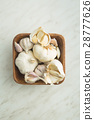 Fresh garlic in wooden bowl. 28777626