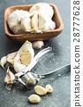 Garlic and garlic press. 28777628