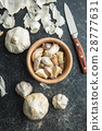 Fresh garlic in wooden bowl. 28777631