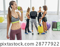 Merry young woman in gym 28777922