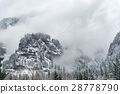 Peak of rock with forest in winter 28778790