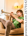 Playing the trumpet in the living room 28779142