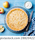 Apple pie on a blue wooden background. Top view 28820422