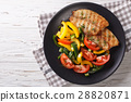 Grilled fish steaks and fresh vegetable salad 28820871