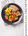 Grilled fish steaks and fresh vegetable salad 28820874