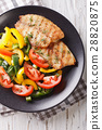 Grilled tilapia fillets and fresh vegetable salad 28820875