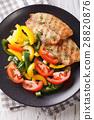 Fried tilapia fillet, fresh salad with pepper 28820876