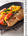 Grilled fish steaks and fresh vegetable salad 28820880