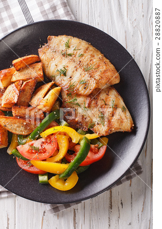 Grilled tilapia fillet, fried potatoes 28820887