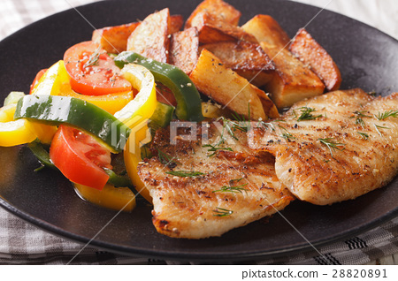 Grilled Tilapia fillet and potato wedges 28820891