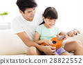 happy Father Teaching daughter To Play ukulele 28822552
