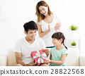 Father receiving gift box from wife and daughter 28822568