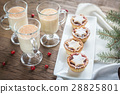 Glasses of eggnog with mince pies 28825801
