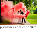 The bride and groom with a red smoke 28827875