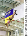 Young athletic woman vaoulting over bar with pole 28830509