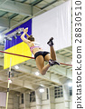 Young athletic woman vaoulting over bar with pole 28830510