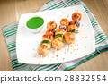 Grilled chicken skewers with zucchini and omatoes 28832554