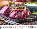 Beef.Raw beef tenderloin steak on a cutting board. 28838047