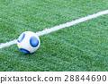 traditional soccer ball on soccer field 28844690