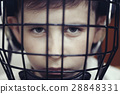 Little boy in the hockey helm. Emotions of child.  28848331