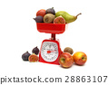 Fruit and kitchen scales on white background 28863107