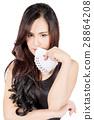 Pretty woman show a card. 28864208