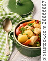 Chicken breasts stewed with vegetables 28866897