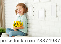 happy laughing  child girl with  yellow tulips at home 28874987