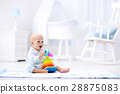 Baby playing with toy pyramid. Kids play 28875083