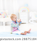 Baby boy with bottle drinking milk or formula 28875184