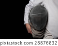 Fencer woman hold her helmet in hand wearing white 28876832