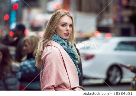 woman walking on the crowd  28884651