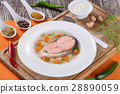 Hearty salmon chowder on white plate with dill 28890059