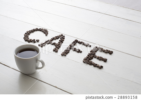 Coffee beans written in cafe letters and coffee cups 28893158