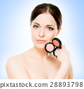 Portrait of a young woman with a makeup pallette 28893798