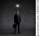 Businessman with a briefcase on a dark background 28896728