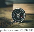 Vintage travel retro compass and vintage book. 28897381