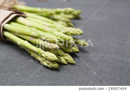 bunch of asparagus over slate 28907494