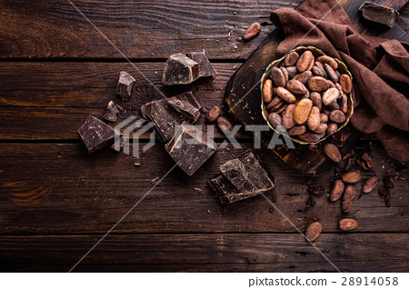 Cocoa beans and chocolate on wooden background 28914058